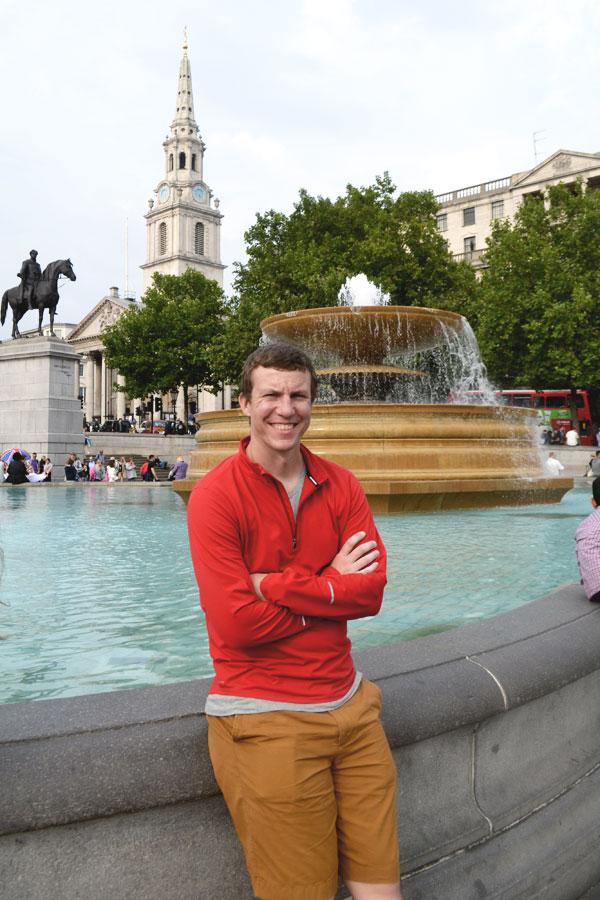 Cale standing near fountain in Trafalgar Square in London